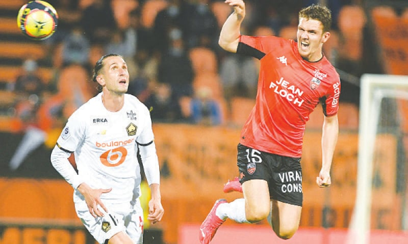 LORIENT: FC Lorient's Julien Laporte (R) vies for the ball with Lille's Luiz Araujo during their Ligue 1 match at the Moustoir Stadium.—AFP