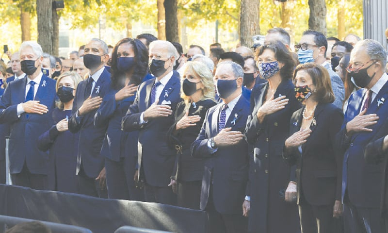 New York: (from left) Former US president Bill Clinton, former first lady Hillary Clinton, former president Barack Obama, Michelle Obama, President Joe Biden, First Lady Jill Biden and other officials stand for the national anthem during the annual 9/11 Commemoration Ceremony at the National 9/11 Memorial and Museum on Saturday. — AP