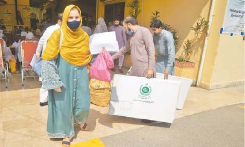 PESHAWAR: Polling staff carry election material on Saturday for the cantonment boards' elections being held on Sunday. — Shahbaz Butt / White Star