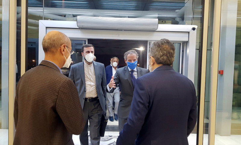 Director General of International Atomic Energy Agency (IAEA) Rafael Mariano Grossi, second right, is welcomed by Deputy Head of the Atomic Energy Organisation of Iran Behrouz Kamalvandi, right, as he is accompanied by Iran's envoy to the IAEA Kazem Gharibabadi, second left, at Tehran Imam Khomeini International Airport, Iran, on Saturday. — AP