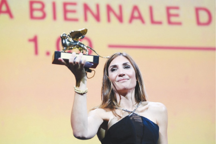 """French director Audrey Diwan acknowledges receiving the Golden Lion for Best Film for  """"L'Evenement"""" (Happening) during the closing ceremony of the 78th Venice Film Festival on Saturday.—AFP"""