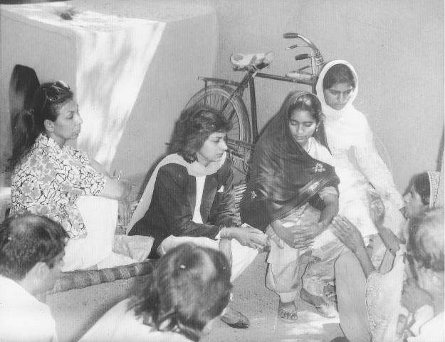 A young Asma Jahangir listens to a group of women | White Star Archives