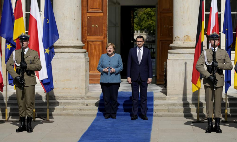 German Chancellor Angela Merkel, left, meets Poland's Prime Minister Mateusz Morawiecki in Warsaw, Poland, on Saturday. — AP