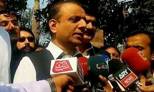 Senior Minister Aleem Khan talks to the media in this file photo. — DawnNewsTV