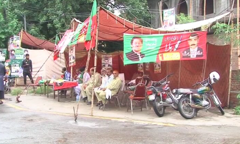 An election camp is seen during polling in Lahore on Sunday.  — DawnNewsTV