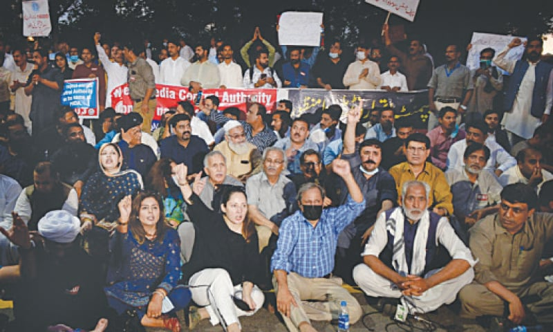 JOURNALISTS raise slogans during their sit-in outside the Parliament House on Sunday.—Mohammad Asim / White Star