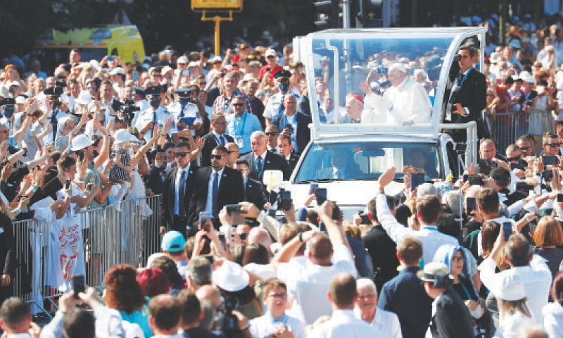 POPE Francis greets people after arriving at Heroes' Square.—Reuters