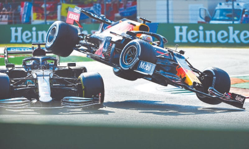 MONZA: Mercedes' Lewis Hamilton (L) and Red Bull's  Max Verstappen collide during the Italian F1 Grand Prix at the Autodromo Nazionale circuit on Sunday.—AFP