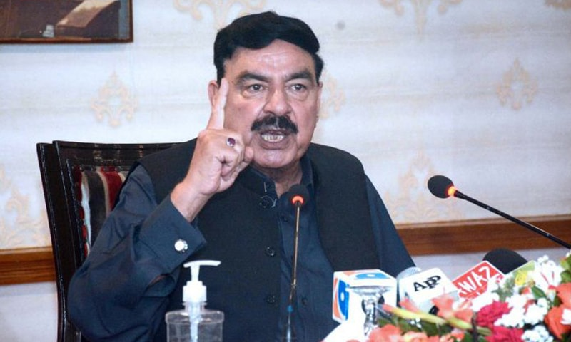 Interior Minister Sheikh Rashid addresses a press conference at a local hotel in Karachi on Sunday. — APP