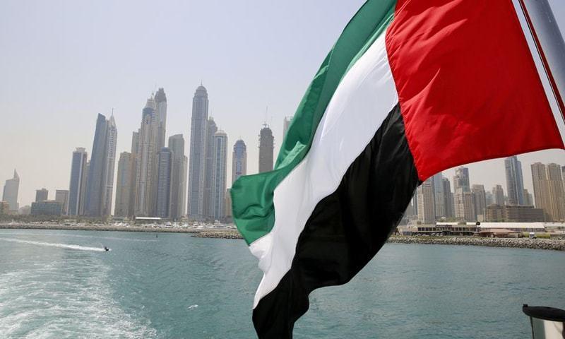 a UAE flag flies over a boat at Dubai Marina, Dubai. — Reuters/File