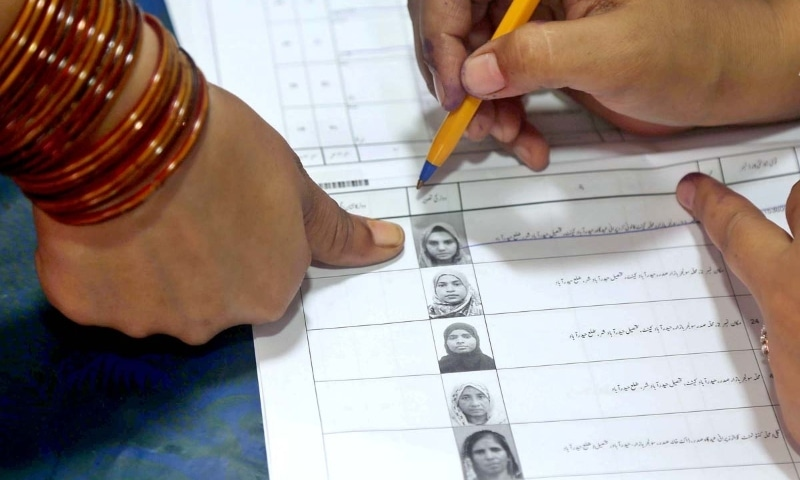 A voter marks her thumb in a polling station during cantonment board election in Hyderabad on September 12. — APP