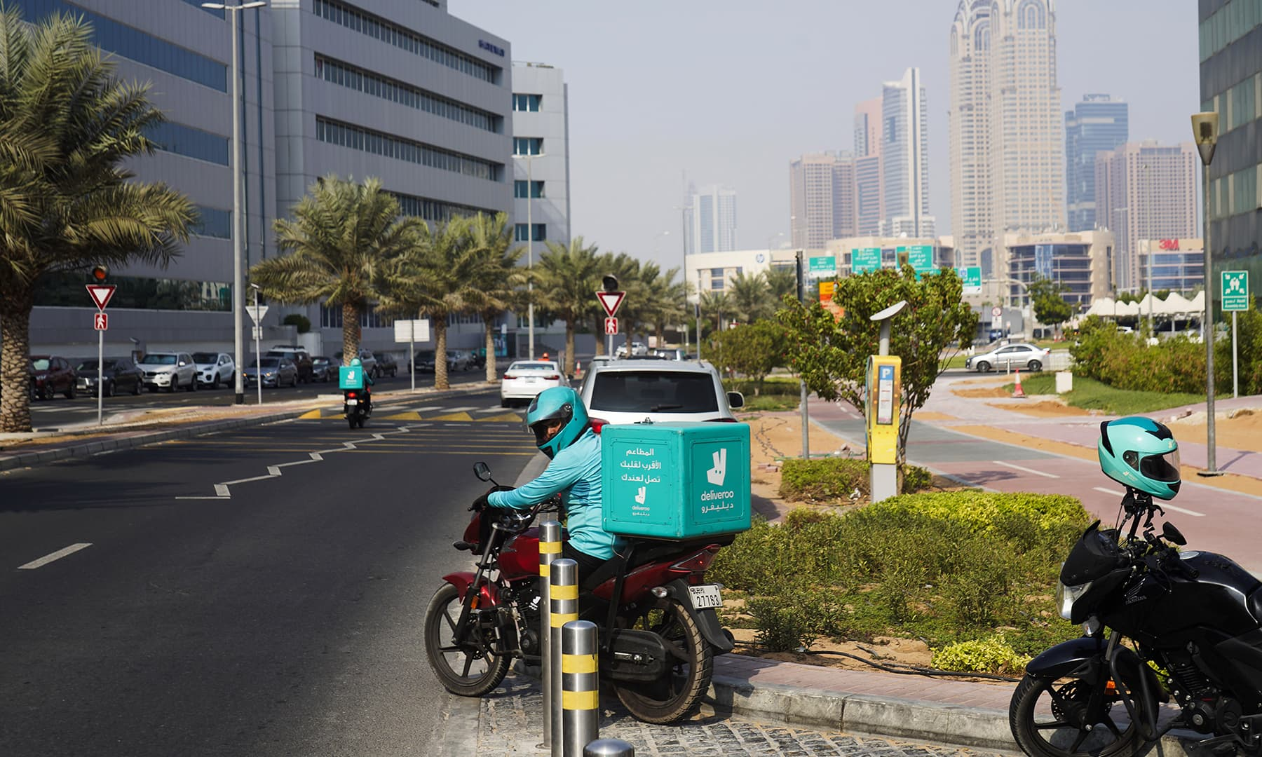 A delivery driver for the app Deliveroo prepares to make a delivery, in Dubai, United Arab Emirates, on Sept 9. — AP