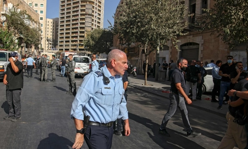 Israeli police officers gather outside the site of a stabbing attack, in Jerusalem on September 13. — AFP