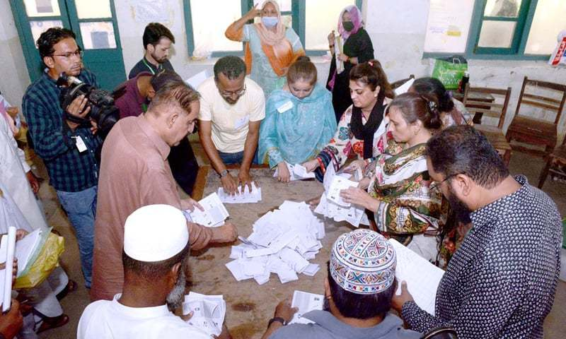 Officials count cantonment board election votes at one of the polling station near Kala Pul, Karachi. — APP