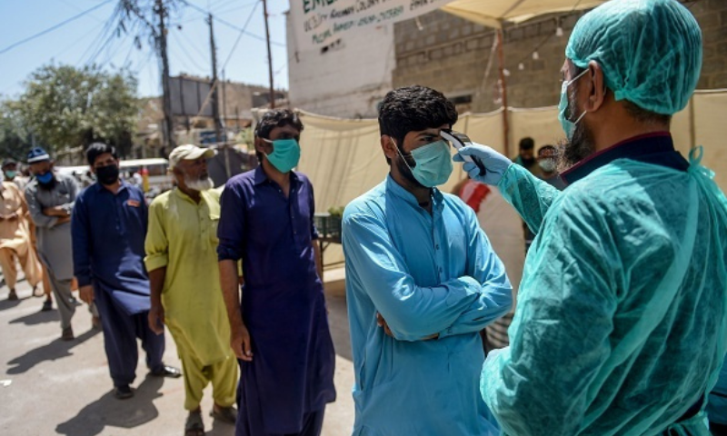 According to the National Command and Operation Centre data, 2,988 cases were reported and 67 people  lost their battle against the virus in a single day across the country. — AFP/File