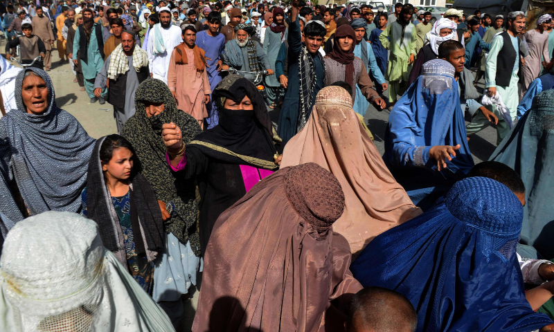 Local residents take part in a protest march against a reported announcement by the Taliban, asking them to evict their homes built on state-owned land in Kandahar on Tuesday. — AFP