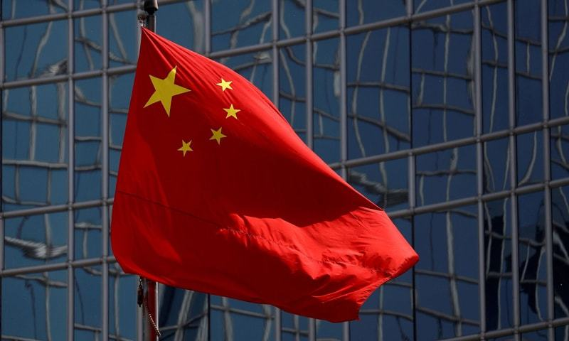 In this file photo, the Chinese national flag is seen in Beijing, China. — Reuters/File
