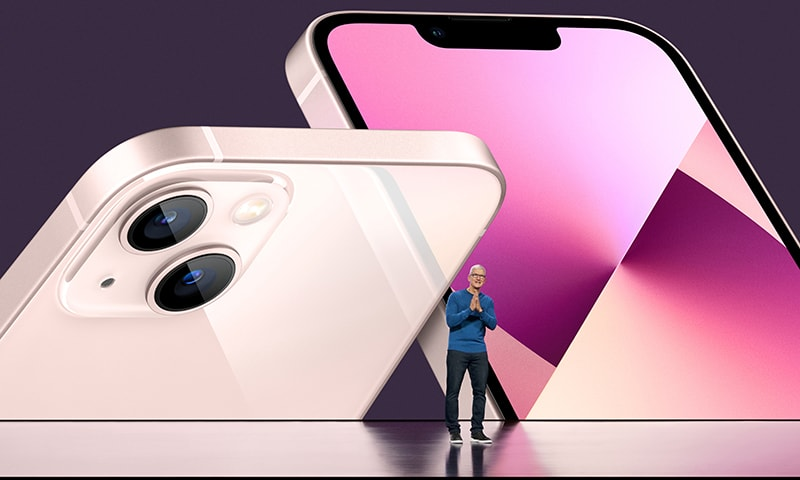 Apple CEO Tim Cook unveils the new iPhone 13 during a special event at Apple Park in Cupertino, California, broadcast September 14. — Reuters