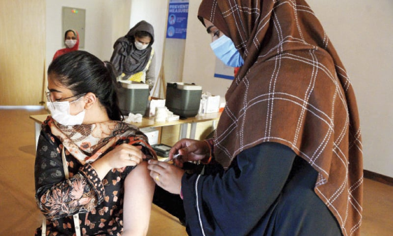 A teenager receives her Covid-19 shot at the vaccination centre in F-9 Park in Islamabad on Tuesday. — White Star