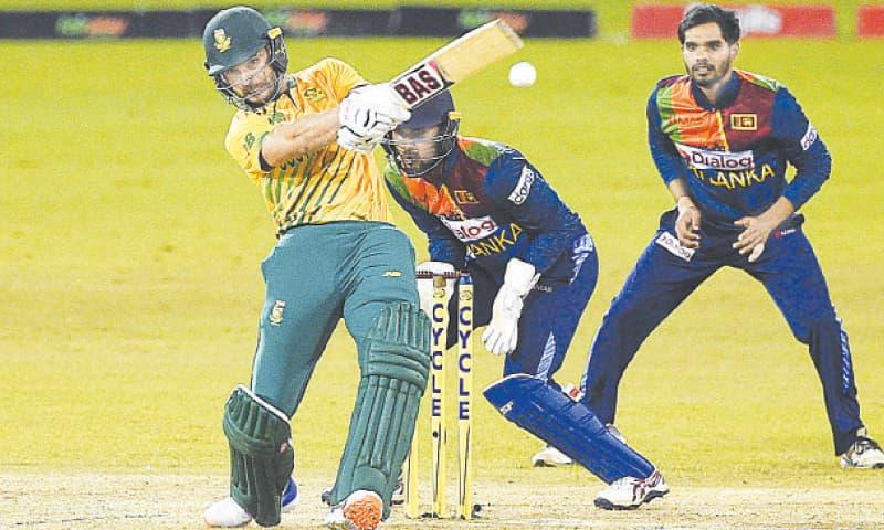 South African opener Reeza Hendricks plays a shot as  Sri Lankan wicket-keeper Dinesh Chandimal looks on during the third Twenty20 International at the R Premadasa Stadium on Tuesday. — AFP