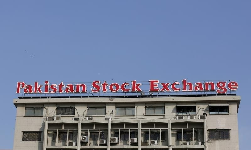 A sign of the Pakistan Stock Exchange is seen on its building in Karachi in 2016. — Reuters