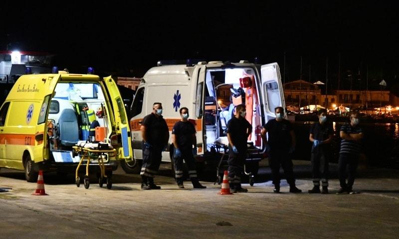 Paramedics wait next to ambulances at Pythagorio port, on the eastern Aegean island of Samos on September 13. — AP