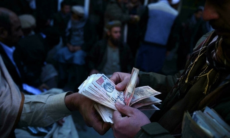 Afghanistan is in the grip of a major cash crisis, with people limited to withdrawing the equivalent of just $200 a day from personal accounts. — AFP