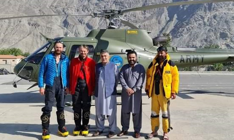 Pakistani mountaineer Wajidullah Nagri and Jakub Vicek and Peter Macek of the Czech Republic pose for a photograph after being rescued and taken to Gilgit via an army helicopter. — Photo by author