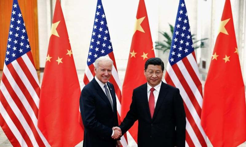 Chinese President Xi Jinping shakes hands with US Vice President Joe Biden (L) inside the Great Hall of the People in Beijing, China on December 4, 2013. — Reuters/File