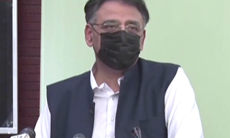Minister for Planning, Development and Special Initiatives Asad Umar addresses a ceremony for International Democracy Day in Islamabad. — DawnNewsTV