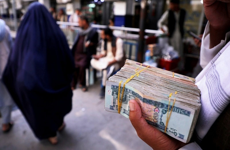 A person holds a bundle of Afghan banknotes at a money exchange market, following banks and markets reopening after the Taliban took over in Kabul, Afghanistan, Sept 4, 2021. — AFP/File