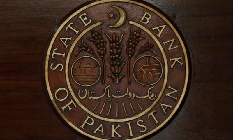 A logo of the State Bank of Pakistan (SBP) is pictured on a reception desk at the head office in Karachi on July 16, 2019. — Reuters