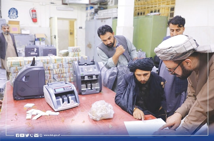 OFFICIALS of Afghanistan's central bank seize a large amount of cash and gold from former top government officials.—Reuters