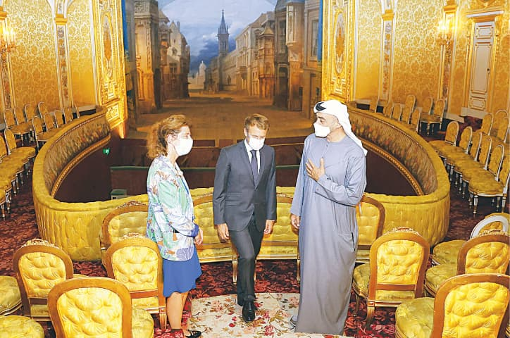 FRENCH President Emmanuel Macron (centre) and Abu Dhabi's Crown Prince Sheikh Mohamed bin Zayed Al Nahyan (right) visit the imperial theatre of the Chateau of Fontainebleau, near Paris.—AFP