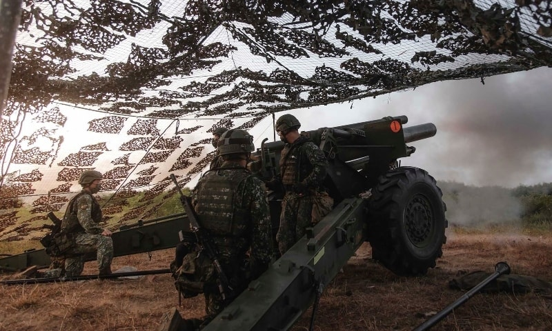 In this photo released by the Taiwan Military News Agency, a Taiwan artillery unit conducts a live firing drill to deter a coastal landing force during the Han Guang exercise held on the island of Penghu county on Wednesday. — AP