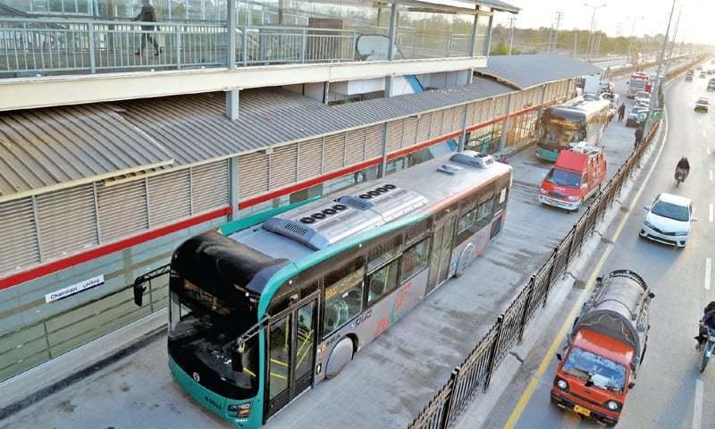 A bus crosses BRT's Chamkani station, Peshawar, during a test run. — Photo by Shahbaz Butt/File