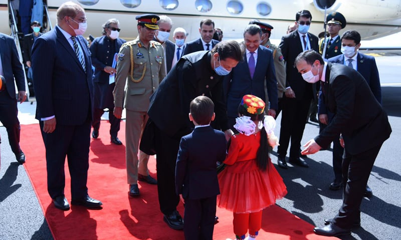 Prime Minister Imran Khan was received by Tajik Prime Minister Kokhir Rasulzoda and accorded a red carpet welcome at Dushanbe International Airport on Thursday. — Photo courtesy Prime Minister's Office Twitter