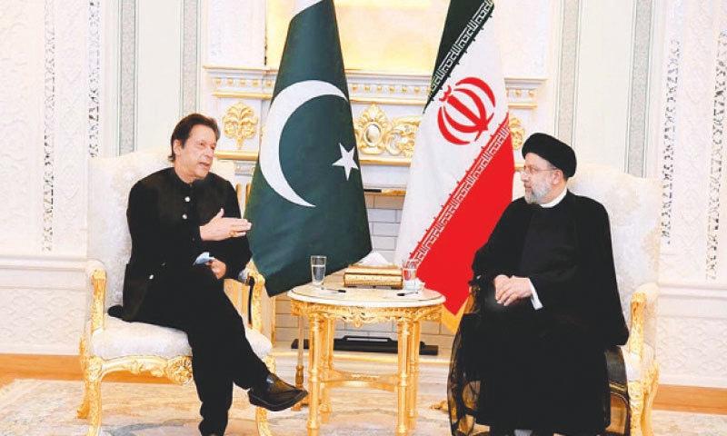 DUSHANBE (Tajikistan): Prime Minister Imran Khan exchanging views with Iran's President Ebrahim Raisi during a meeting on Thursday.—PPI