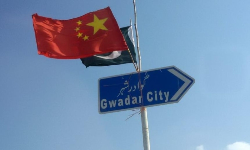 In this 2016 file photo, the Chinese and Pakistani flags fly on a sign along a road towards Gwadar. — Reuters
