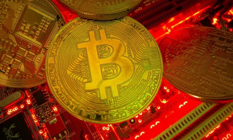 Representations of the virtual currency Bitcoin stand on a motherboard in this picture illustration taken May 20. — Reuters
