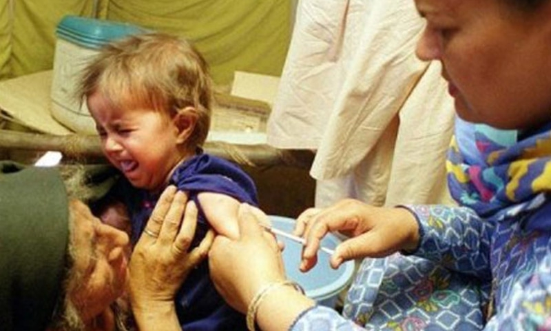 In this file photo, a medic injects a child with the measles vaccine. — AFP