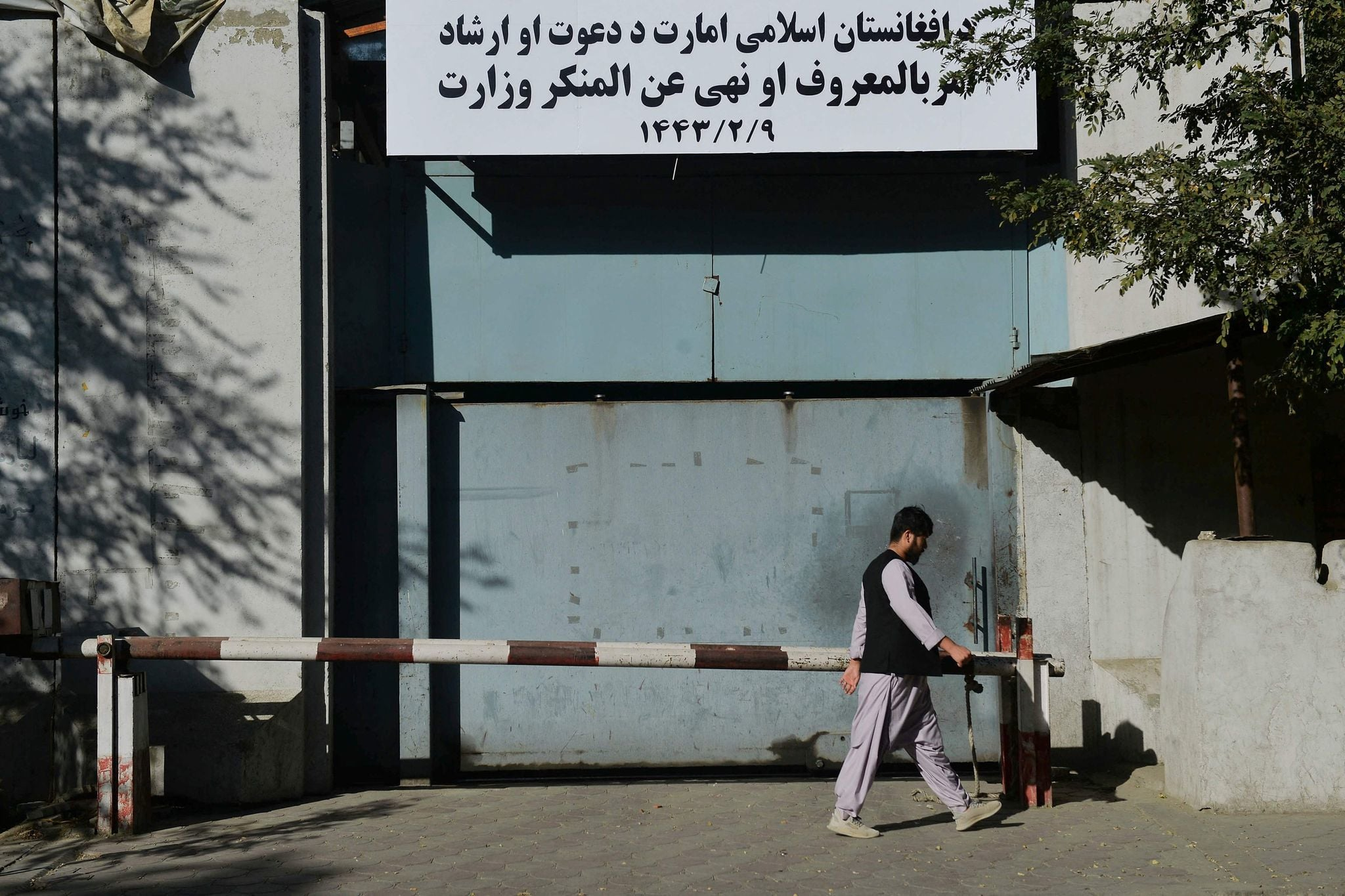 A man walks past an entrance gate of the Ministry for the Promotion of Virtue and Prevention of Vice in Kabul on September 17. — AFP