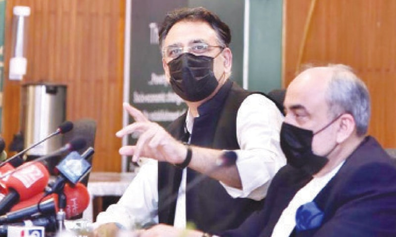 FEDERAL Minister for Planning, Development and Special Initiatives Asad Umar addressing the press conference.—APP