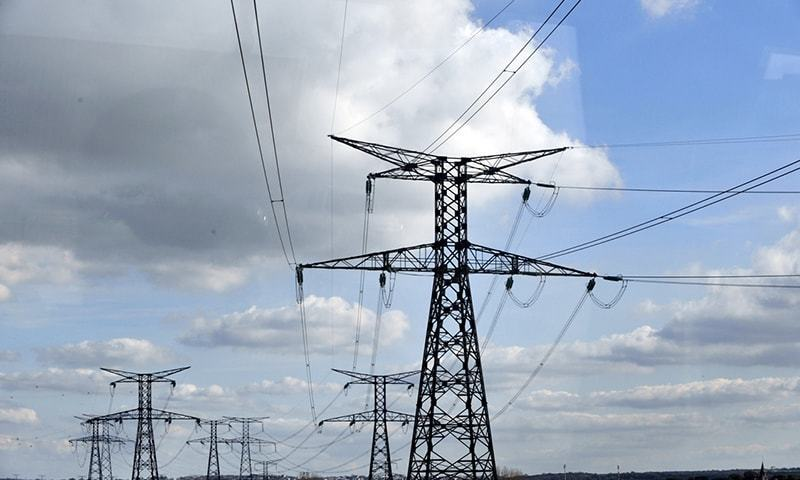 This file photo shows a view of power lines linked to an old nuclear plant. — AFP/File