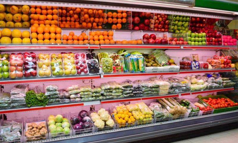 Fresh local and imported vegetables and fruits are displayed at a superstore in Karachi. — Dawn/File