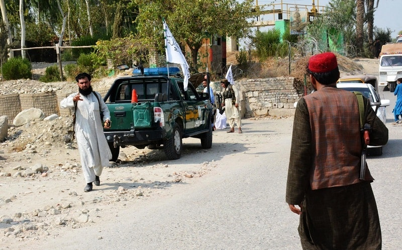 Taliban members inspect the site of a blast in Jalalabad on Saturday. — AFP
