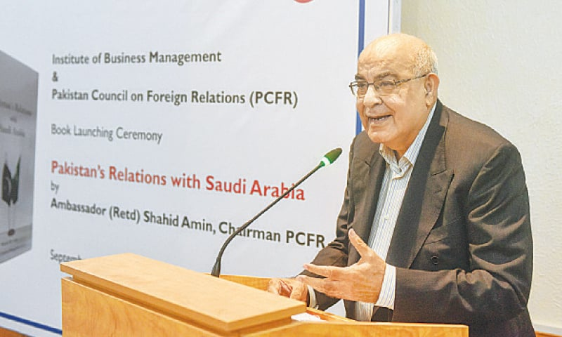 FORMER ambassador Shahid Amin, author of the book, speaks at the launch at IoBM on Saturday.—White Star