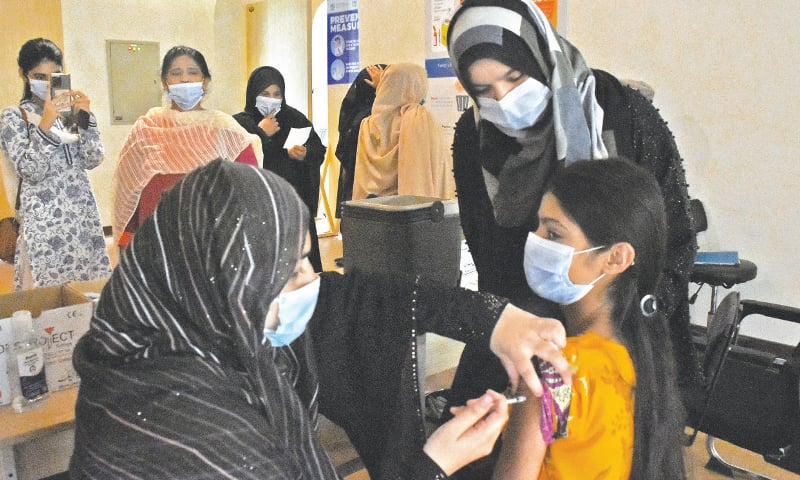ISLAMABAD: A girl receives Covid-19 vaccine at a vaccination centre on Saturday. — Online