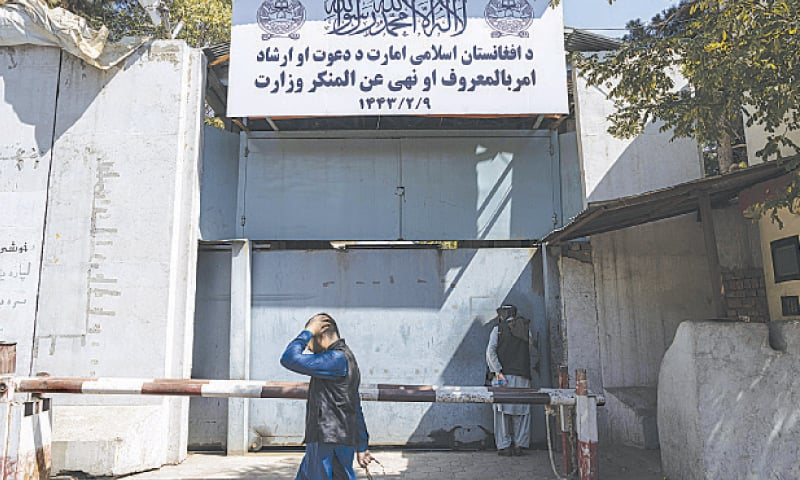 AN AFGHAN man walks past the former Women's Affairs Ministry building in Kabul on Saturday. — AP