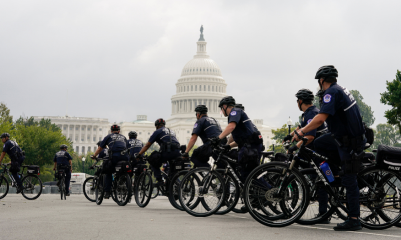 Police officers on bicycles watch before a rally near the US Capitol in Washington on Saturday. — AP